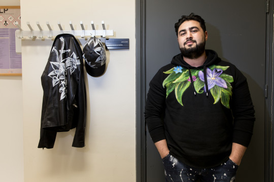 Pharmacy student and artist Ardy Samandarpour (ArdyArt) with his work: painted items of clothing. He works for Memphis Depay, among others. Photo: Pepijn van den Broeke